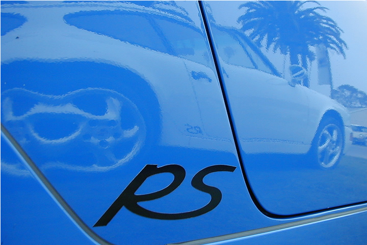 Don T's Grand Prix White RSA reflected in Warren G's Maritime blue example at the Ventura German AutoFest Sep 2003.